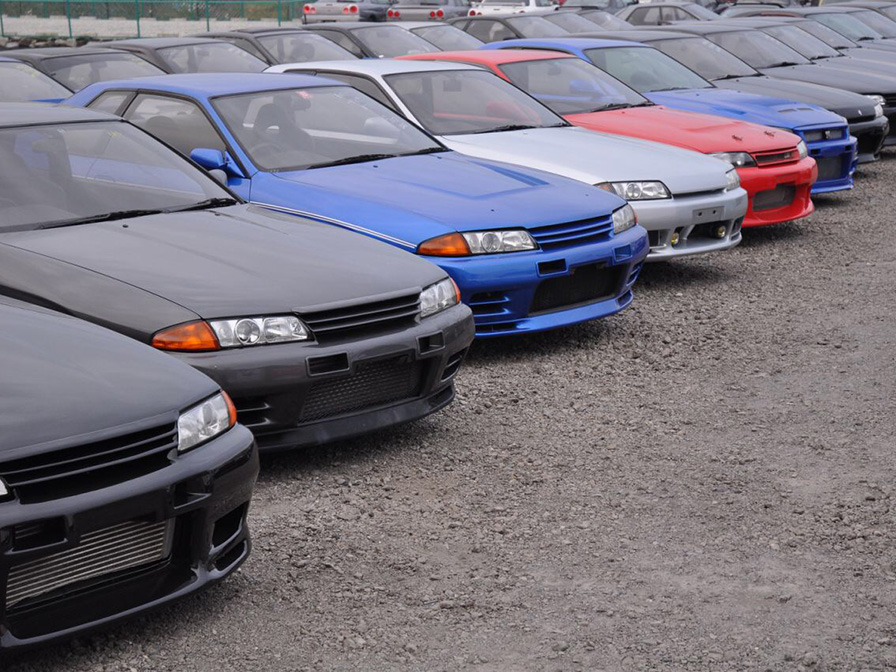 Japanese used cars stock. Cars standing in line in front of our yards in Japan